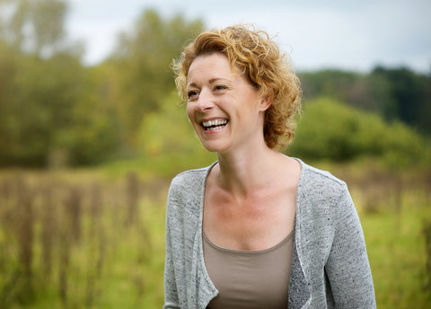woman happy about calendula benefits