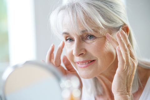 woman using chamomile to minimize signs of aging