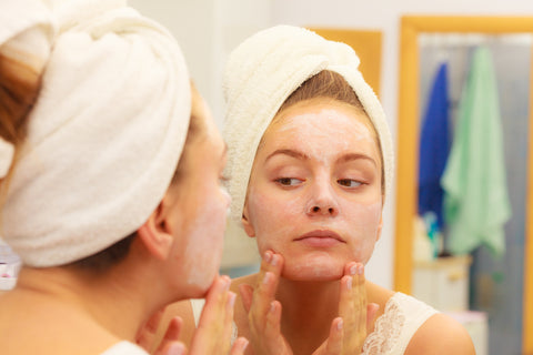 Woman using chamomile for her skin