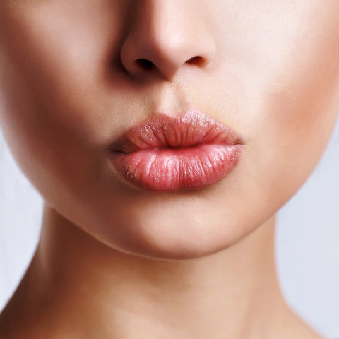 woman doing a kissy face with her non dry lips