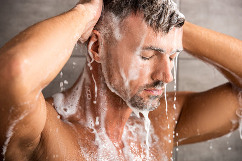 man washing hair with chemical-free shampoo
