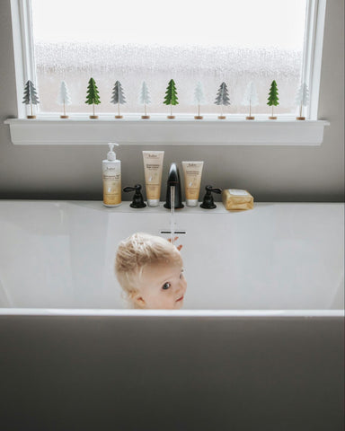 baby taking a bath with colloidal oatmeal