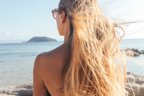 Girl with blonde hair flowing in the wind