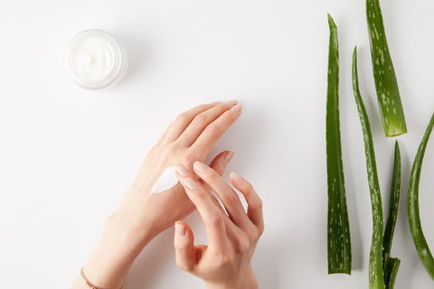 Aloe based lotion being applied to cracked skin