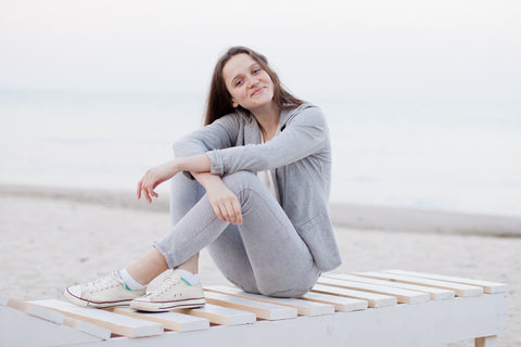 Woman sitting on a bench at the beach