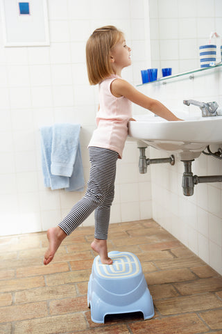 young girl excited about hand washing