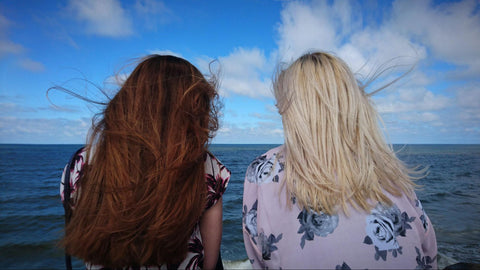 The back of a blonde and brunette