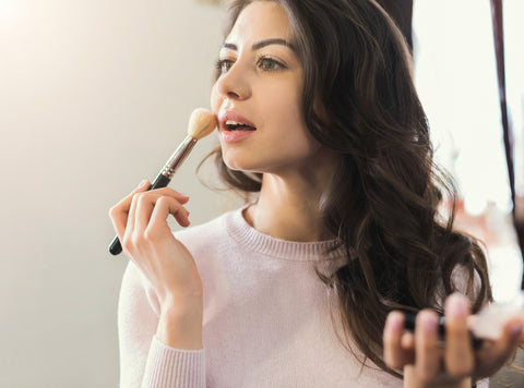 Woman applying mineral make up