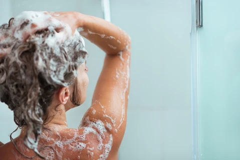 Woman washing her hair in the shower