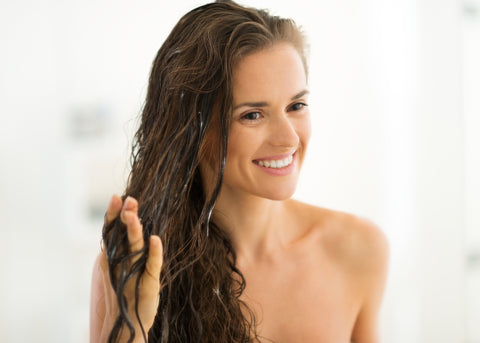 Woman conditioning hair