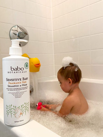 Baby taking a bath with Babo hypoallergenic shampoo