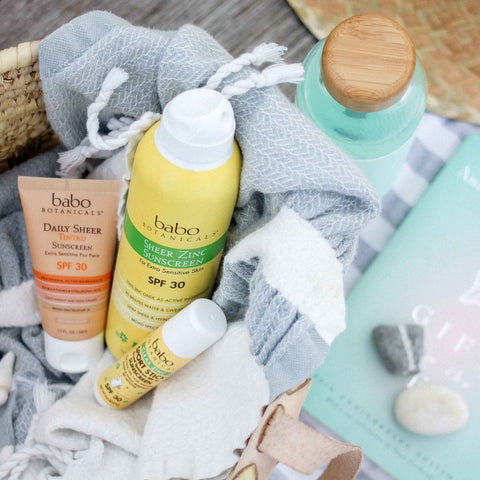 A basket of Babo Botanicals organic sunscreen products