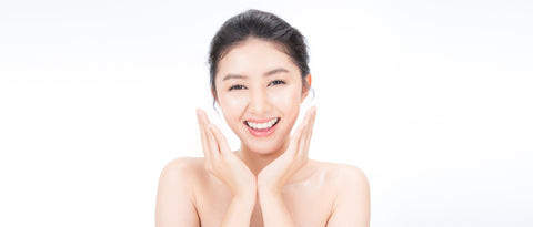 happy woman caring for her skin naturally