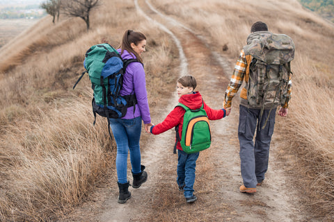 Family out hiking after checking their packing list for vacation