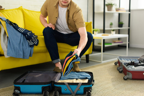 Woman using her packing list for vacation to prepare for a trip