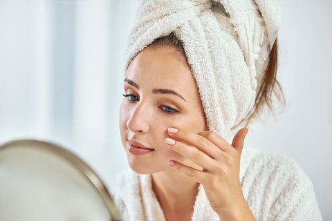 woman cleaning face to prevent eczema
