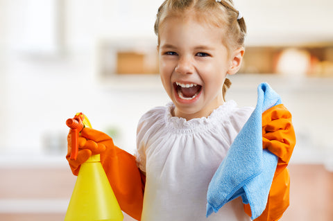 kid with cleaning supplies excited to clean