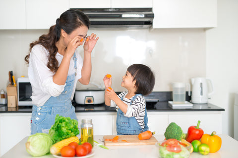 parent cooking with her kid