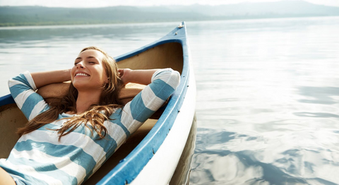 girl relaxing in a canoe wearing safe sunscreen