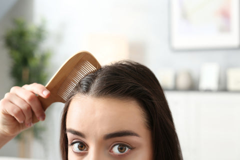 Woman showing how to moisturize your scalp