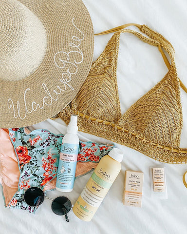 Vacation packing with bathing suit and sun care products containing shea butter