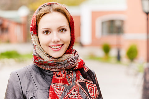 Woman covering her soft hair with a scarf