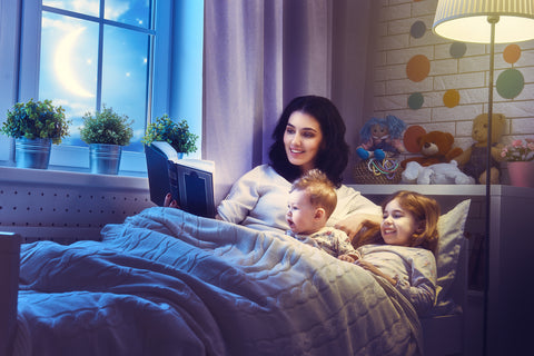 Mom reading to kids as a part of toddler bedtime routine