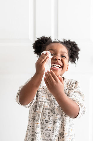 Child washing face while learning her toddler schedule