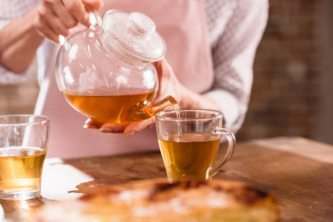 pouring herbal tea