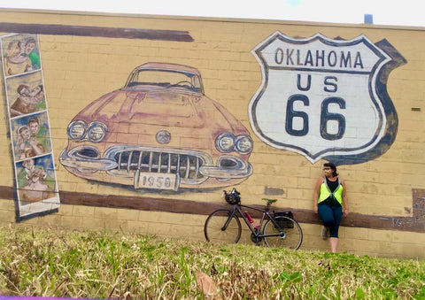 Route 66 mural in OK woman with bicycle and yellow cute reflective high visibility safety vest