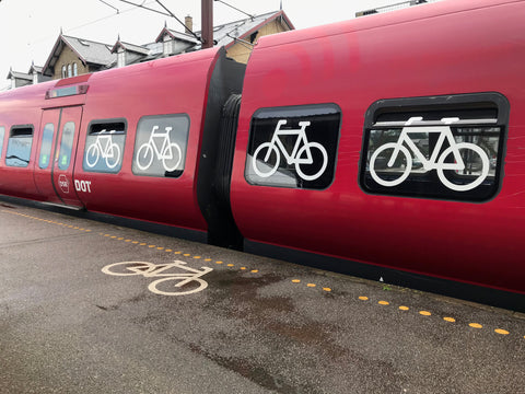 bicycles painted on platform and on a train car dedicated to bicycles in Copenhagen Denmark