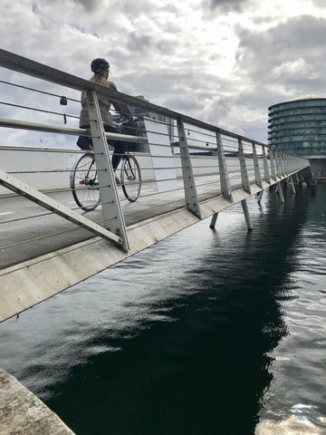 a woman cyclist crosses a cycling and pedestrian bridge only for walking and biking in Copenhagen Denmark