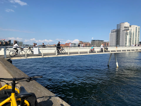 bikers and cyclists crossing a cycling and pedestrian bridge only for walking and biking in Copenhagen Denmark
