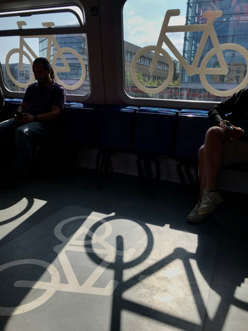 shadows and bicycles painted inside a bike train copenhagen denmark