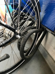 bicycle wheel held in prong stand on a train car dedicated to bicycles in Copenhagen Denmark
