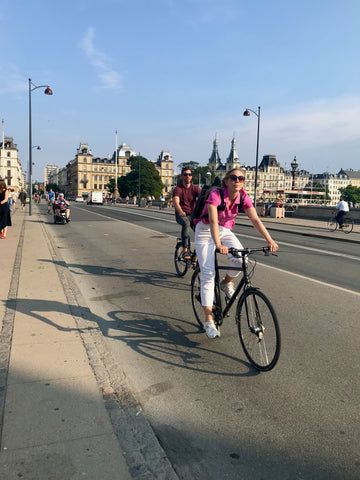 a woman on a bike crosses Dronning Louises Bro Queen Louise's Bridge, the most heavily traveled cycling bridge in Copenhagen, some 40,000 cyclists cross it every day