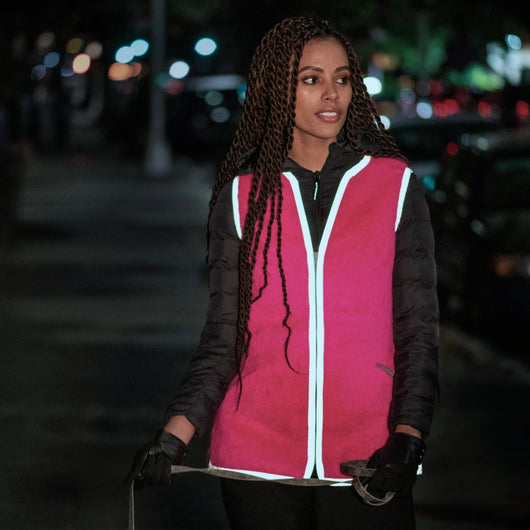 beautiful woman wearing stylish high vis reflective safety vest mohair  fur vest walking dog walking at night in shocking pink mohair scarf vest and jacket with reflective trim stylish designer reflective safety gear wear hi vs high visibility be seen at night reflective fashion by Vespertine haute reflecture cute style pretty independent designer made in Nyc fall 2020 winter 2021 womens fashion  womens fashion wearpink shopping pinktober breast cancer awareness month BCRF research foundation