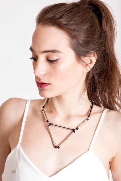 Aztec necklace is made of hand-cut and galvanized brass, onyx and galvanized metal components.
