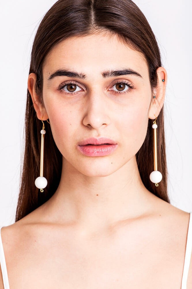 Bellevue earrings made of hand-cut, hand polished and galvanized brass, white coral and gold plated sterling silver.
