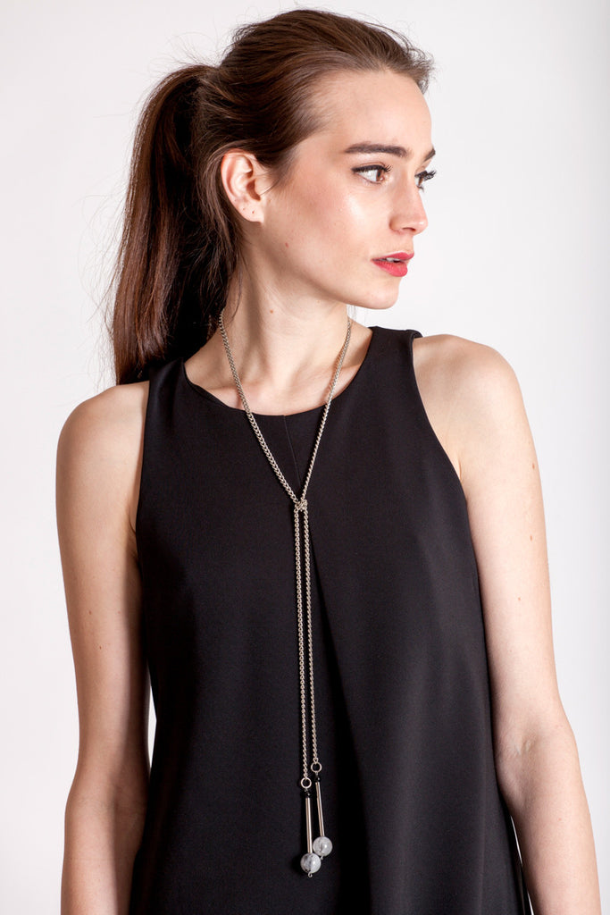 The Bellevue necklace features hand-cut and galvanized brass, onyx, rutilated quartz and galvanized chain.