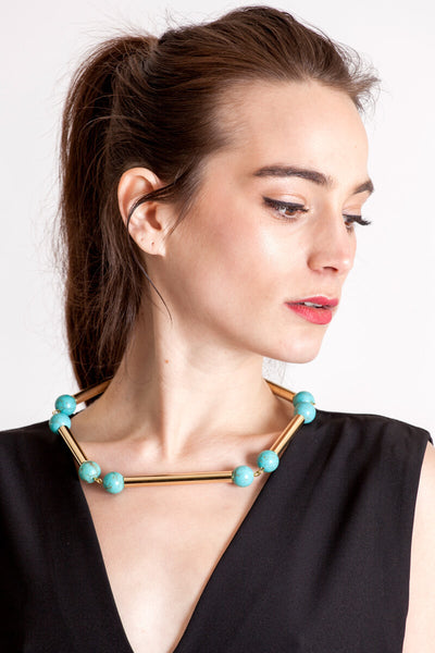 The Bonbon necklace made of warm turquoise (gold edition) and cold brass, which was hand-cut and galvanized.