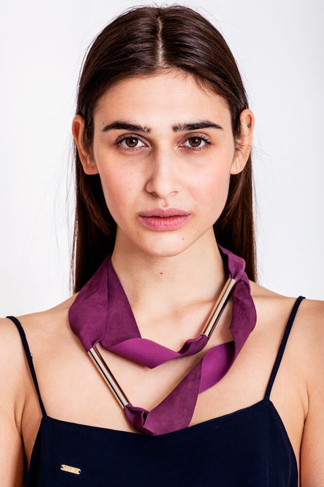 Embrassme necklace made of finest sheep napa, hand-cut, hand polished and galvanized brass and metal components. Purple-gold edition.