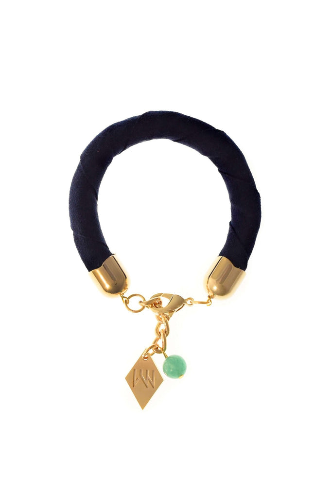 The no. 11 edition of the handcuff bracelet is made of navy blue suede with galvanized metal components with aventurine. Gold edition.
