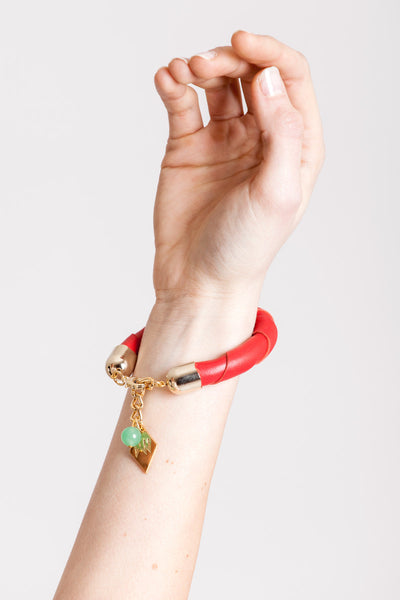 The no. 19 edition of the handcuff bracelet is made of red leather with galvanized metal components with aventurine.