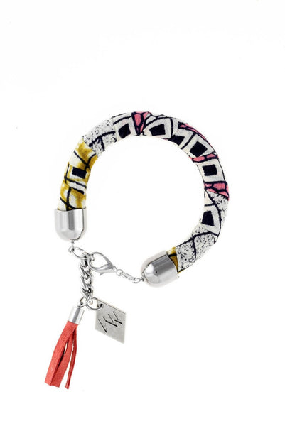 Bracelet made of african batik cotton with galvanized metal components and leather tassel. Silver edition.