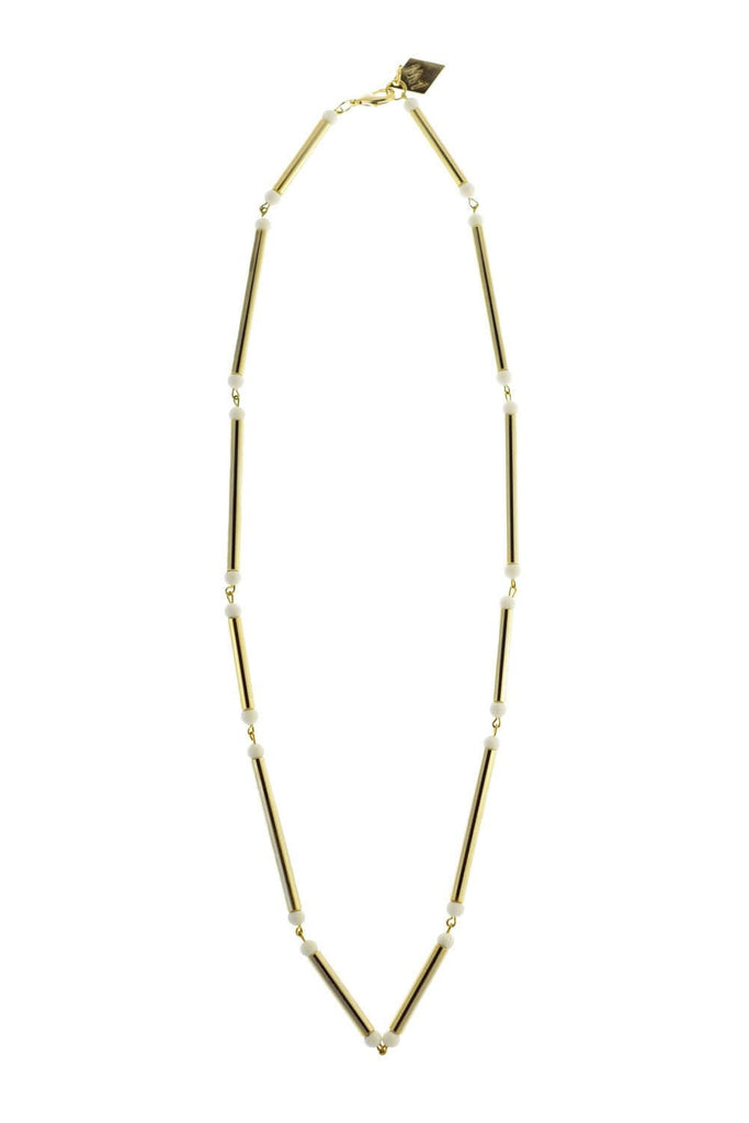 Hidden lines gold edition made of hand-cut, hand polished and galvanized brass featuring white coral.