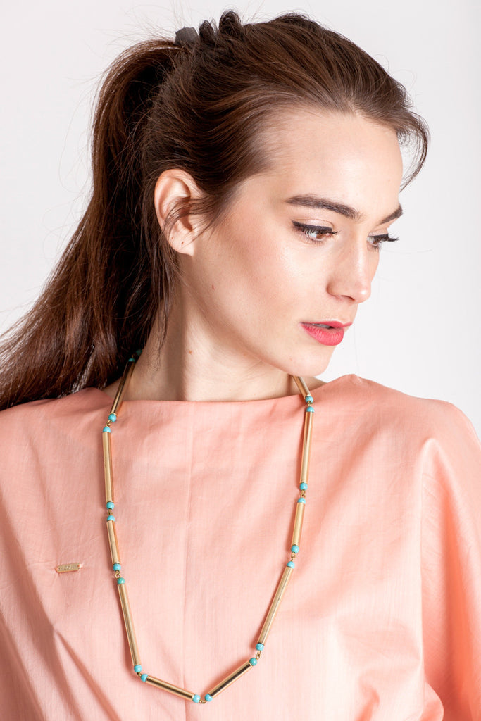 Hidden lines long necklace made of hand-cut, hand polished and galvanized brass featuring turquoise.