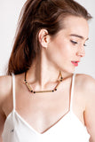 Hidden Lines necklace is made of hand-cut and galvanized brass and onyx.