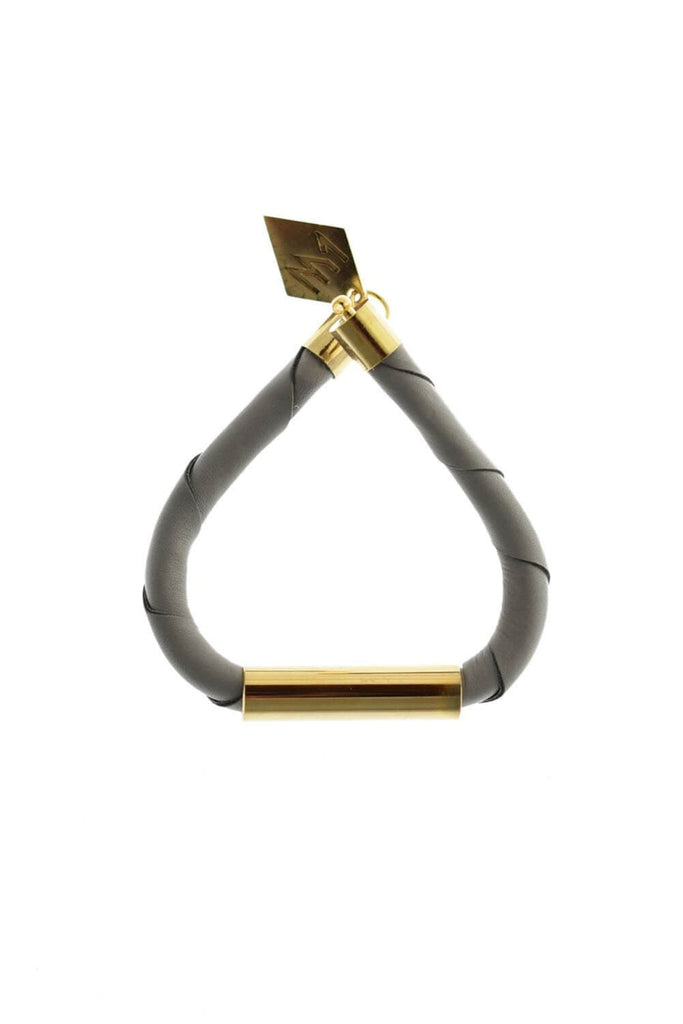 Line cuff made of light gray leather and hand-cut, hand polished and galvanized brass. Gold edition.