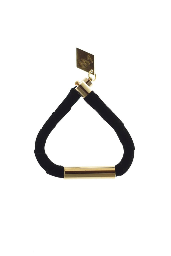 Line cuff made of black suede and hand-cut, hand polished and galvanized brass. Gold edition.